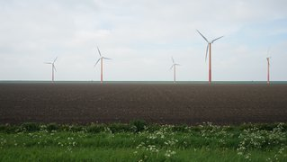 Field with modern windmills Assen