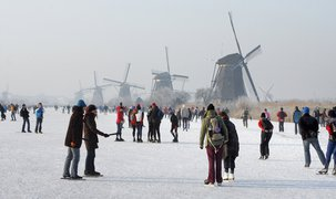 Ice skating near historical windmills Kinderdijk